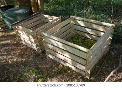 Compost bin as simple wooden silos in the garden, selected focus