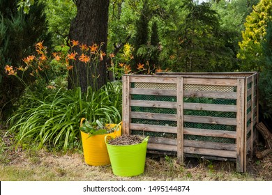 Compost bin in a summer garden