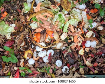 Compost pile with layers of organic matter and soil