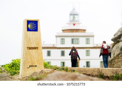 Compostela pilgrims in Fisterra , Finisterre , way st James signal  km 0