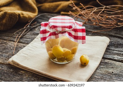 compote of grapes in a jar, standing on a wooden table