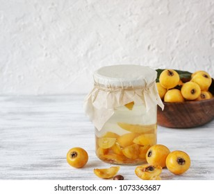 compote or syrup from a loquat in a glass jar. Preparation of a syrup from a loquat with sugar. canning fruit.
