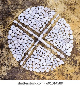 Compound of pebbles laid out in the form of a cross