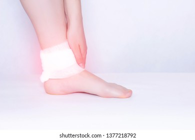 Compress and ankle support to eliminate pain, inflammation and dislocation of the ankle joint, close-up, copy space, osteoarthritis