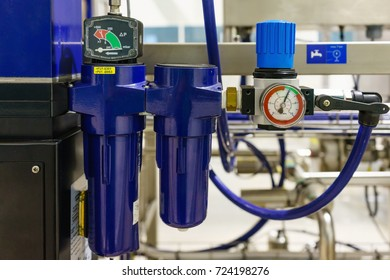 Compressed air filter regulator lubricator.
