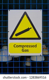 Compressed gas sign warning people to be  careful - health and safety