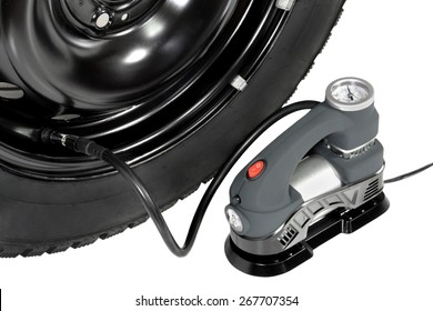 compressor inflates the wheel . white background