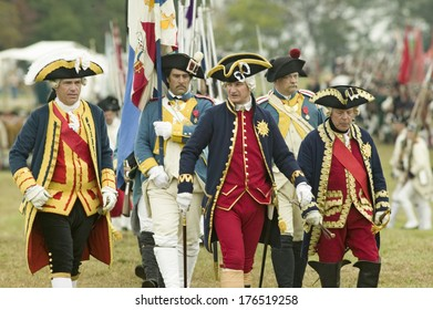 Compte De Grasse, Major General in casual attire, General RochambeauPatriot soldiers march Surrender Field as part of the 225th Anniversary of the Victory at Yorktown, a Revolutionary War, Virginia.