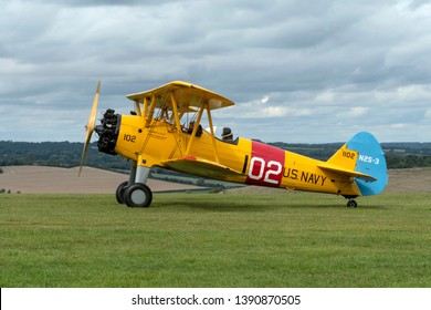 Compton Abbas, Dorset/United Kingdom - 09/08/2018: a Boeing Stearman Model 75, N2S-3 biplane taxiing at the beautiful and tiny Compton Abbas airfield