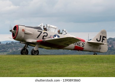 Compton Abbas, Dorset/United Kingdom - 09/08/2018:  This T6 North American Harvard looks beautiful as it makes its way to take off at Compton Abbas airfield, situated near Shatesbury in Dorset