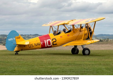 Compton Abbas, Dorset/United Kingdom - 09/08/2018: A Boeing Stearman biplane ready to take off from Compton Abbas airfield in Dorset