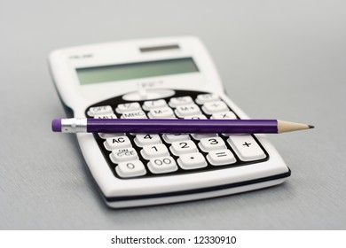 Computational objects - pocket calculator and graphite pencil