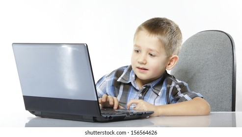 Computer addiction child boy with laptop notebook white background