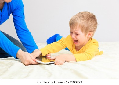 computer addiction, parent taking out touch pad from child