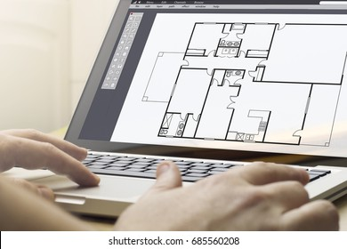 computer aided design concept: man using a laptop with cad software on the screen. Screen graphics are made up.