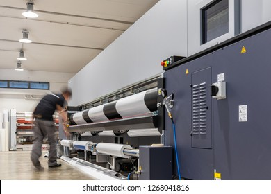 Computer aided printing process, advanced technology in the press and publishing sector, latest generation robotized plotting machines for mass production and big format prints.