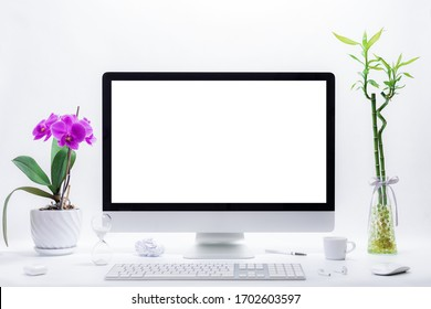 Computer all in one mockup, home and office workspace concept. Computer with white blank screen on work table front view. Copy space