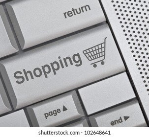Computer blue keyboard with on-line shopping symbol on it