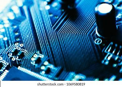 computer board capacitors blue color close up.