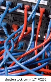 Computer Cables Chaotically Plugged In To The Back Of A Server