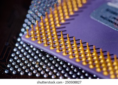 computer cpu (central processor unit) chip on main board from close-up