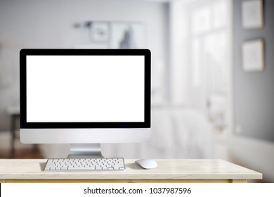 Computer desktop with blank screen and other accessories on marble table.