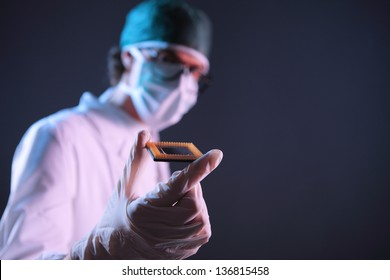 Computer engineer examining a microchip cpu