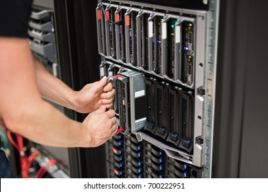 Computer Engineer Installing Blade Server In Data Center