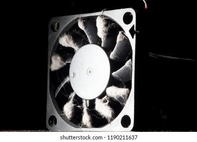 computer fan with blades covered with a thick layer of dust