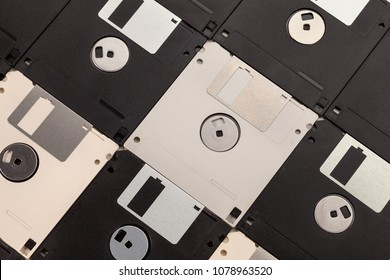 Computer floppy disk background - white and black diskettes in diagonal lines