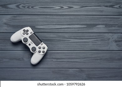 Computer game competition. Gaming concept. Top view of a joystick on wooden planks