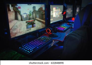 computer gamer  in internet cafe