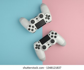 Computer gaming competition. Gaming concept. Two white joysticks on color background.