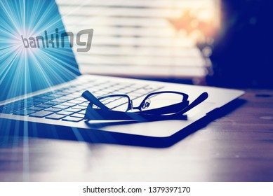 Computer, glasses and online banking