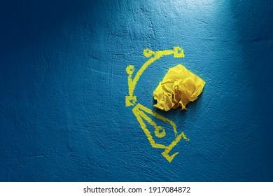 Computer graphic designer propagation concept. No idea, creativity improvement concept. Yellow crumpled paper (symbol of unsuccessful design without idea) and symbol of pen tool and Bezier curve.