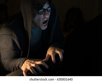 Computer hacker man stealing information with laptop