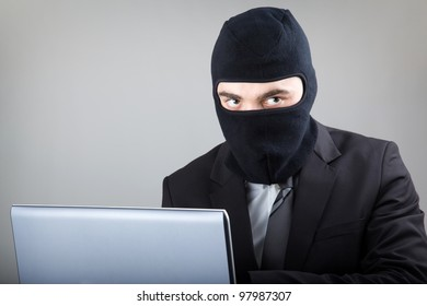 Computer Hacker in suit and tie