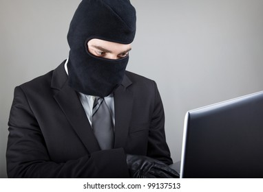 Computer Hacker in suit and tie