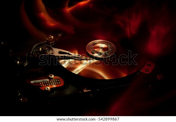 computer hard drive and abstract background fire