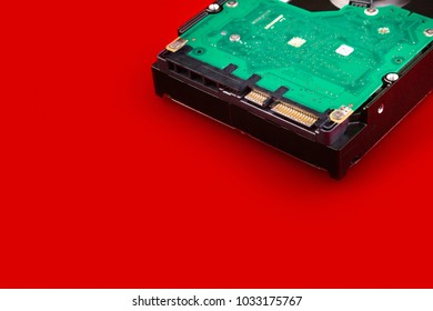 Computer hard drive on a red background with space for your text. Computer data storage