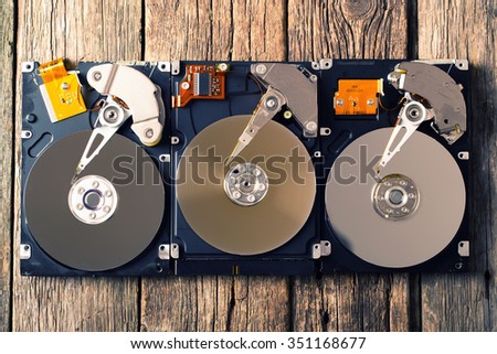 Computer hard drive on wooden background