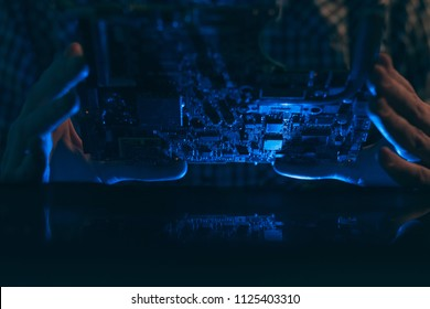 computer hardware development. microelectronics technology science concept. engineer holding a computer component