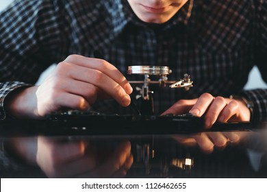 computer hardware development. microelectronics technology science concept. engineer diagnosing or testing digital component