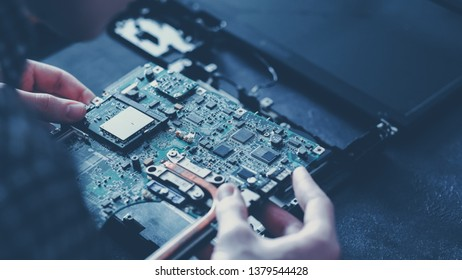 Computer hardware development. Microelectronics technology science concept. Engineer holding modern motherboard.