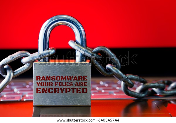 Computer has been blocked access to Data with Ransomware. Can not access Data by Malware,Encrypt and Hacking Conceptual with Padlock.The Old padlock and Chains On Laptop with Red Screen.