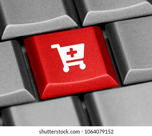 Computer key - cart with add sign