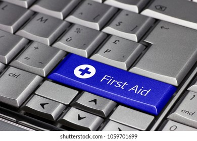 Computer key - first aid with cross in a white circle