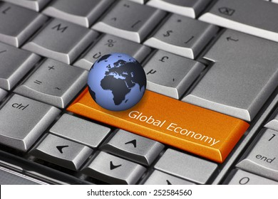 Computer key with globe showing Europe and Africa - Global Economy