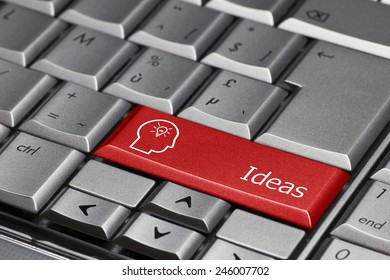 Computer key - Ideas with the the silhouette of a man and a light bulb