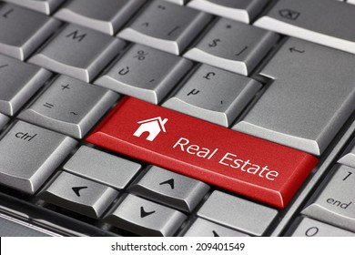 Computer key - Real Estate with house icon